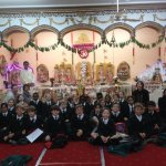 Children from local school visiting temple and learning about Hindu culture